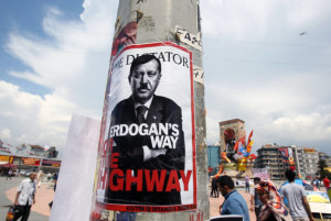 A picture of Prime Minister Recep Tayyip Erdogan, altered to look like Adolf Hilter, is stuck  onto  a electricity column at the Taksim square in Istanbul on Thursday, June 6, 2013. Turkish officials, scrambling to contain tensions, have delivered more conciliatory messages to thousands of protesters denouncing what they say is the government's increasingly authoritarian rule and its meddling in lifestyles. (AP Photo/Thanassis Stavrakis)